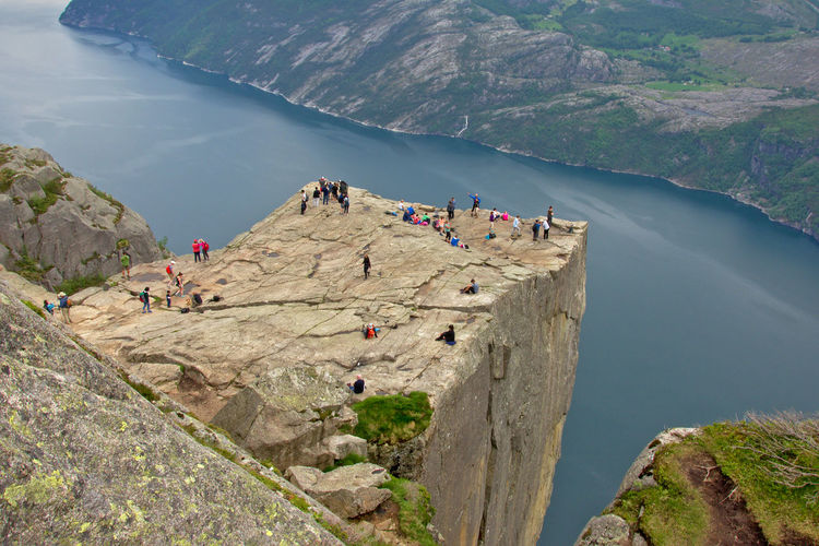 The famous Preikestolen or Pulpit rock in Norway, view from above Lysefjord Norway Preikestolen Pulpit Rock Rock Scandinavia Stavanger Adventure Cliff Fjord Hike Hiking Hiking Landscape Large Group Of People Leisure Activity Lifestyles Mountain Nature Outdoors Overhead View Physical Geography Real People Scenics Sky Steep