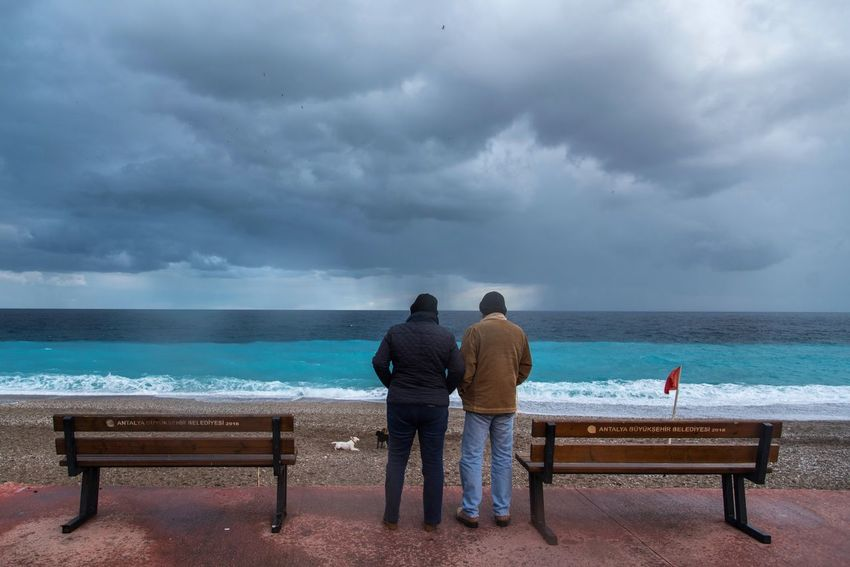 Stormy Weather Sea Horizon Over Water Rear View Water Sky Cloud - Sky Scenics Beach Beauty In Nature Two People Tranquil Scene Tranquility