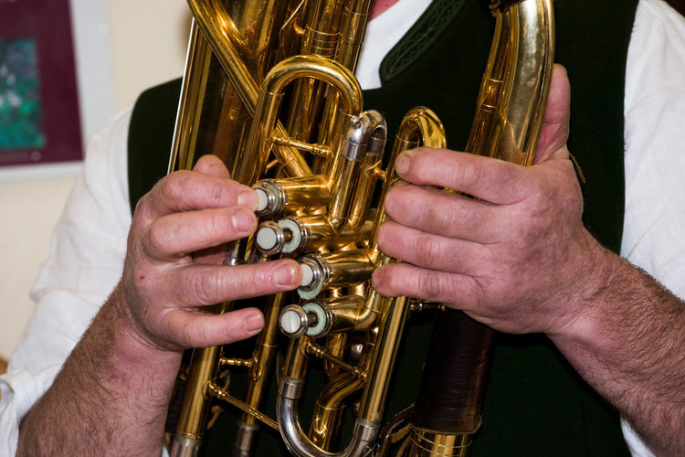 Close-up of man playing musical equipment