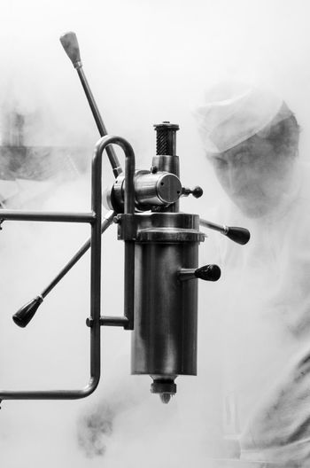 Low angle view of smoke emitting from industry andrés a fritter machine