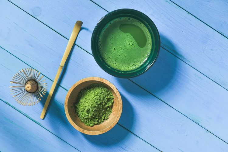 Organic Green Matcha Tea in a Bowl Matcha Tea Food And Drink High Angle View Green Color Freshness Household Equipment Green Tea Tea Food Drink Still Life Wood - Material Blue Kitchen Utensil Bowl Indoors  Ceremony Tray