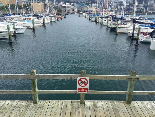 No swimming at the marina Water Harbor Pier No Swimming Sign Warning Sign Boats