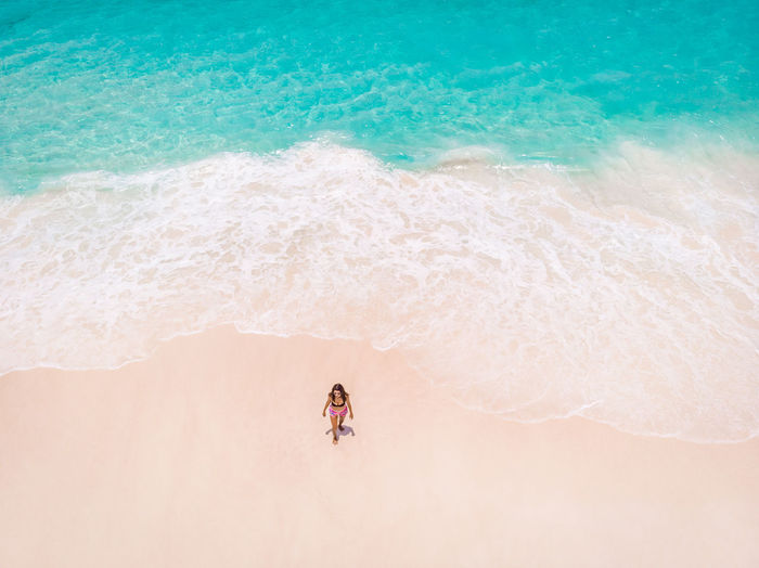 High angle view of person on beach, seychelles tropical island