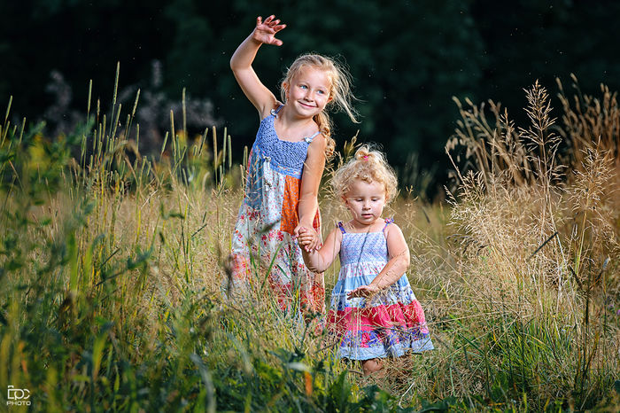 Grass Happiness Joy Fun Beauty Females Idyllic Summer Two People Smiling Sunlight People Nature Holding Beauty In Nature Sibling Village Sun Mood Togetherness Day Outdoors Childhood Girls Family