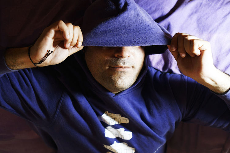Close-up of man wearing hooded shirt