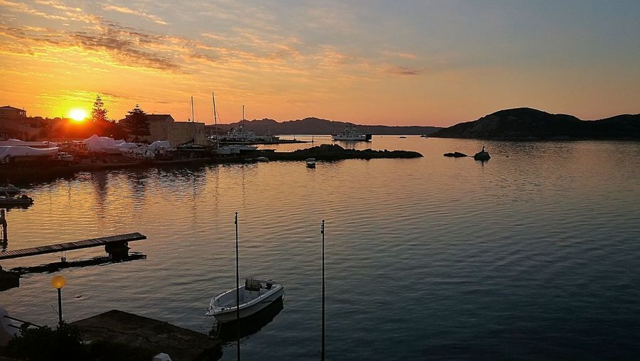 Sunset Water Reflection Sea Sky Outdoors Nautical Vessel Cloud - Sky Silhouette No People Scenics Nature Mountain Beauty In Nature Horizon Over Water Day Lamaddalenaisland Sardinia Sardegna Italy  Travel Destinations Clear Sky Landscape Tranquility Harbor Yacht Arts Culture And Entertainment