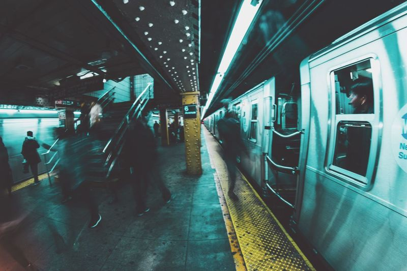Defocused Image Of Train At Railroad Station During Night
