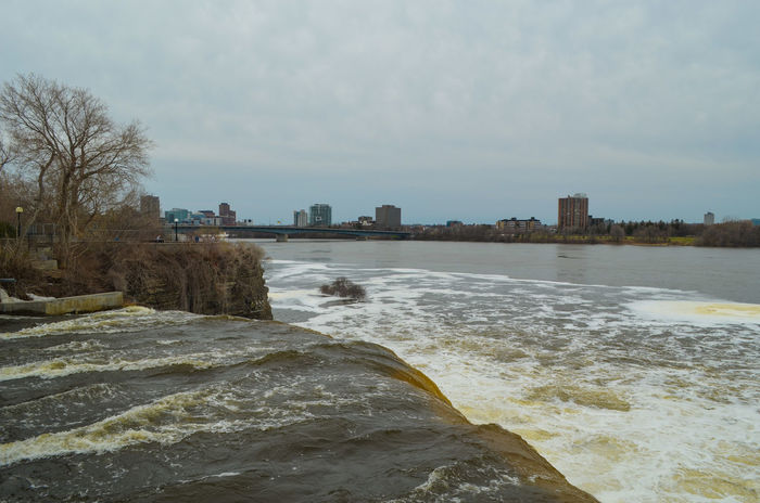 Bronze water Beach Outdoors Sky City Landscape Nature Water No People Day Urban Skyline Cityscape Backgrounds Freshness Cold Temperature Rideau Canal Ottawa Nature Eyeem Photography Horizon Over Water