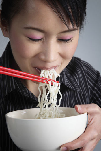 Woman Eating Noodles With Chopsticks