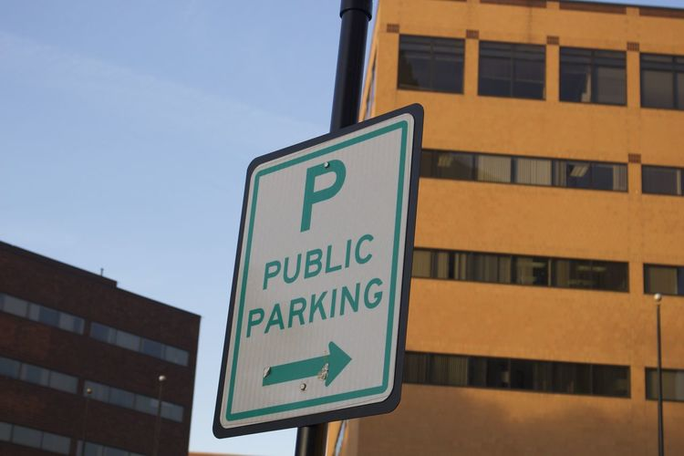 Close-up of parking signboard