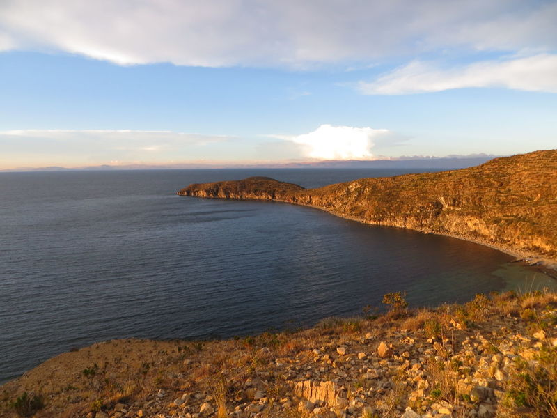 Isla Del Sol, Titicaca lake, Peru Beauty In Nature Calm Cloud Cloud - Sky Cloudy Coastline Day Horizon Over Water Idyllic Landscape Mountain Nature Non Urban Scene Outdoors Peru Remote Rock - Object Rock Formation Scenics Sea Sky Titicaca Tranquil Scene Tranquility Water