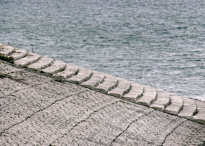 High angle view of footpath by sea
