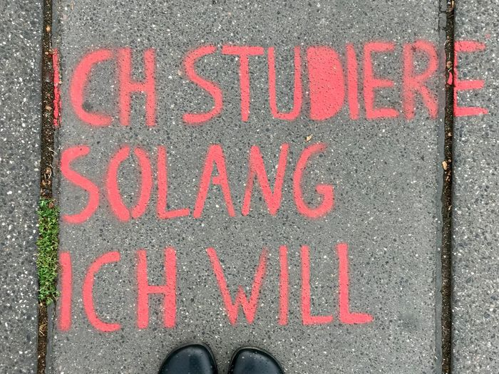 I study as long as I want Studieren Study German Germany Communication Western Script Text Shoe Capital Letter Sign Body Part Red Directly Above Human Leg Outdoors Message Human Foot Close-up