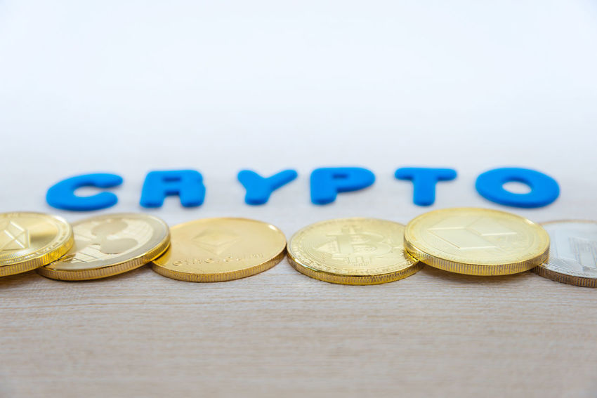 Still Life Indoors  Text Finance Currency Coin Wealth Business Large Group Of Objects Western Script Close-up Selective Focus No People Table Copy Space Blue Studio Shot Communication White Background Economy