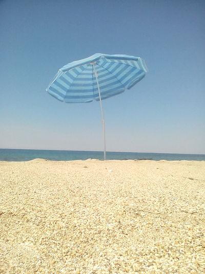 Sand Getting A Tan Unbrella Sunshine Enjoying The Sun Sea Being A Beach Bum Relaxing