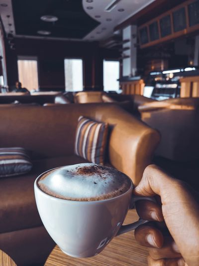 coffee Iphoneonly Iphone8plus Food And Drink Cappuccino Portrait Photography Coffee KSA Indoors  Drink Food And Drink Coffee Refreshment Close-up Coffee - Drink Frothy Drink Chair Business Focus On Foreground Freshness Coffee Cup No People Restaurant Mug Still Life Cup Table Seat