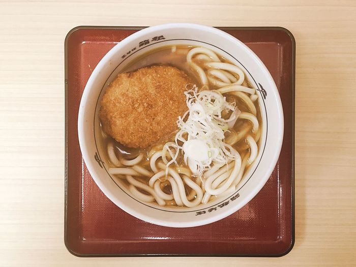 Noodle soup with cutlet on tray