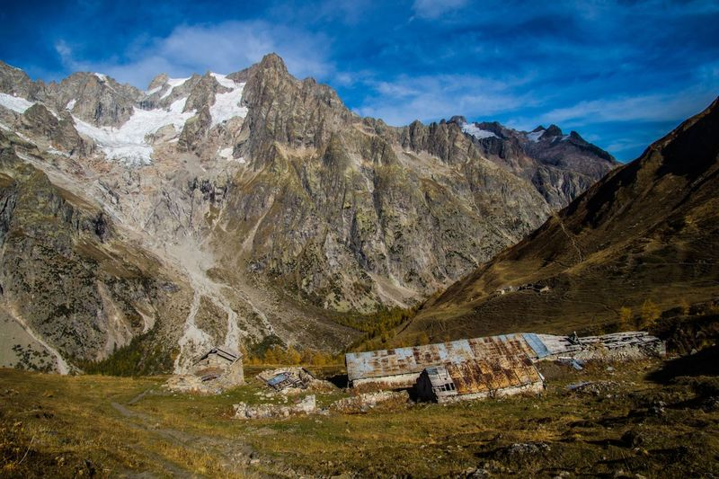 refuge bonatti,courmayeur,italy Mountain Scenics - Nature Mountain Range Environment Sky Landscape Cloud - Sky Nature Beauty In Nature Day Solid Land Rock No People Architecture Rock - Object Outdoors Water Travel Destinations Tranquility Mountain Peak