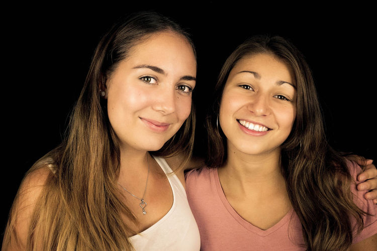 best friends Adult Black Background Cheerful Close-up Day Friendship Happiness Headshot Long Hair Looking At Camera People Portrait Real People Selfie Smiling Studio Shot Togetherness Two People Young Adult