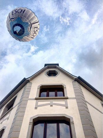 Balloon meets Architecture Hotairballoon Architecture Blue Blue Sky Cloudsandsky Esch  Mersch Lëtzebuerg Luxembourg Balloontrophy2016