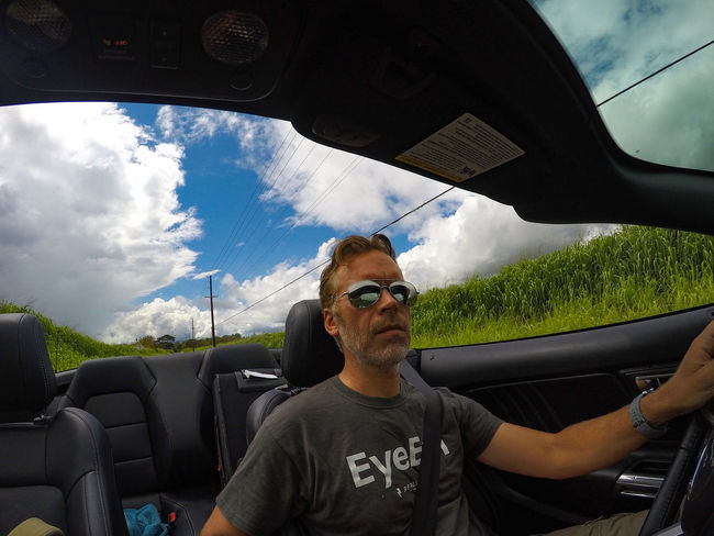 Driving the north shore of Oahu Car Car Interior Convertible Cruisin EyeEm EyeEm Shirt Ford Ford Mustang Having Fun Hawaii Mustang Oahu On The Road One Man Only One Person Open Top Outdoors Roadtrip Self Portrait Sports Car Sunglasses The Drive Transportation USA Let's Go. Together. Second Acts