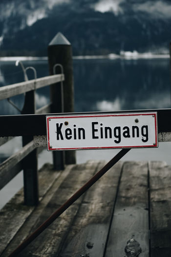 Kein Eingang Communication Text Sign Water Western Script Focus On Foreground Day No People Non-western Script Railing Script Nature Close-up Outdoors Information Safety Wood - Material Information Sign Barrier Guidance No Entry Deutsch Kein Zugang Kein Zutritt Kein Eingang