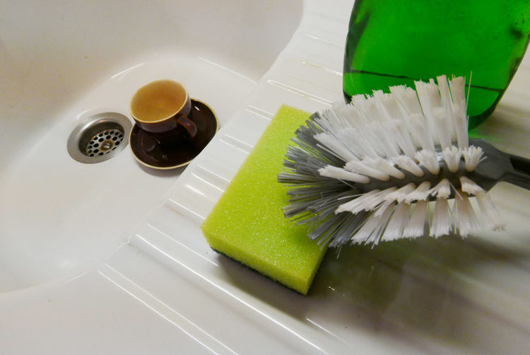 High Angle View Of Cleaning Objects By Sink