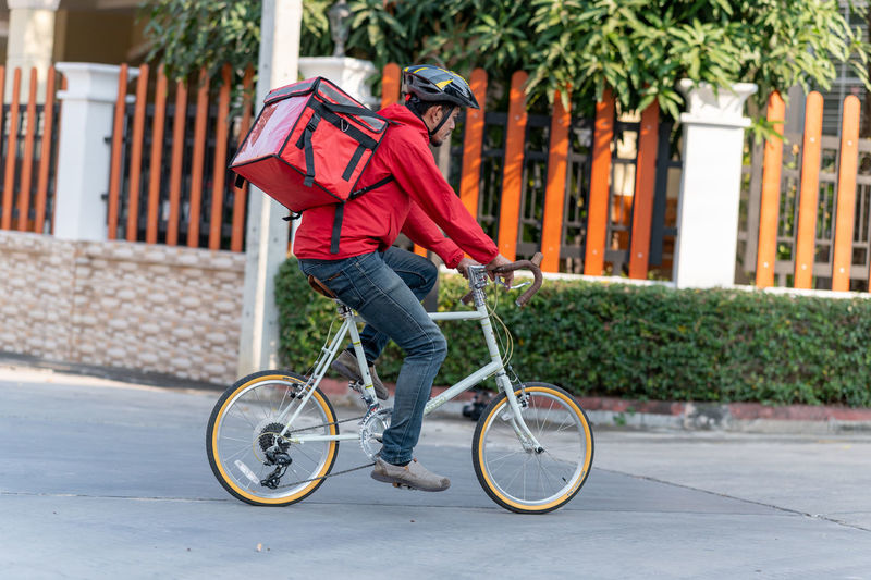 Side view of man riding bicycle