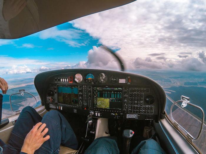 Panoramic view of sea seen through airplane window