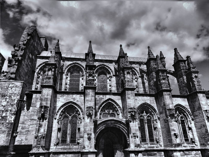 EyeEm Best Shots EyeEmNewHere Rosslyn Chapel Scotland Spirituality Architecture Built Structure Cloud - Sky History Low Angle View Mystery Place No People Religion Spirituality Travel Destinations Your Ticket To Europe Investing In Quality Of Life The Week On EyeEm Black And White Friday