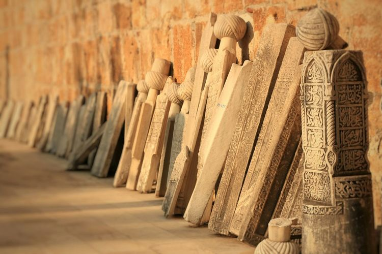 Carved Wooden Planks Leaning Against Wall