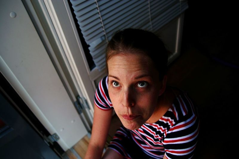 High angle view of thoughtful woman sitting at home