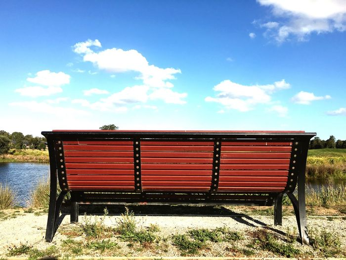 Scenic View Of Bench Against Sky