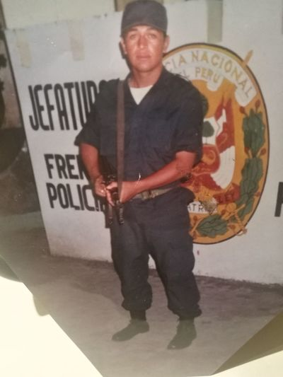 Jeffe De Groupo Policeman Peru AK 47 One Man Only Only Men One Person Looking At Camera Adults Only Portrait Adult People Front View Standing One Mature Man Only Mature Adult Men Full Length Indoors  Smiling Day
