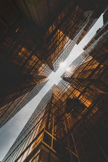 Directly below shot of modern office buildings against sky