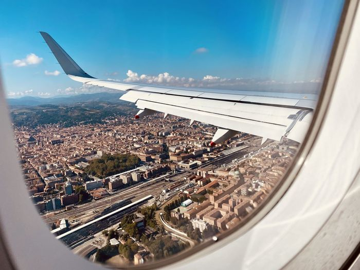 Aerial view of cityscape seen through airplane window