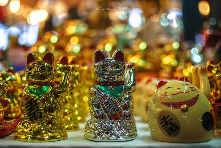 #Bokeh #festivaloriente Animal Representation Animal Themes Art Art And Craft Cat Lovers Celebration Christmas Christmas Decoration Christmas Ornament Christmas Tree Close-up Creativity Cultures Decoration Figurine  Focus On Foreground Human Representation Indoors  Multi Colored Torino ❤ Toy Tradition
