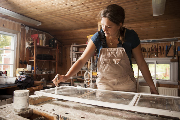 Full length of woman working on table