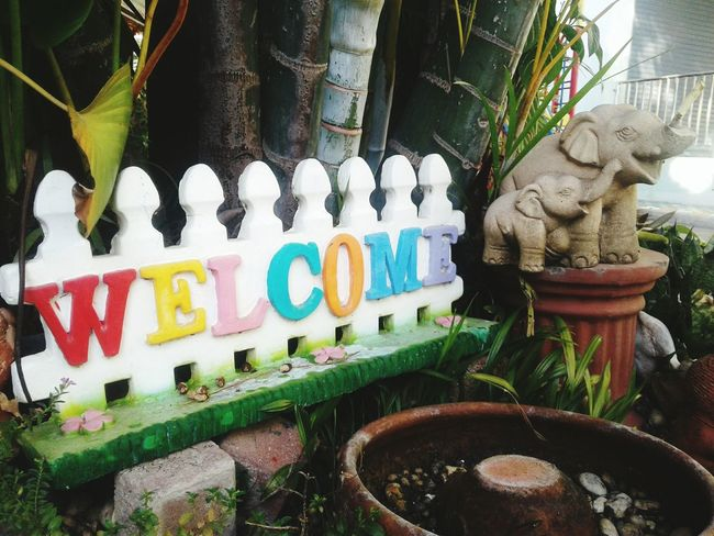 sign welcome Sign White Blue Green Color Plant Elephant Dall Kid Happy Colors Child Play Park Outdoors Indoors  Handmade Paint Design Objects Happy Hello Welcome Day No People Outdoors Statue Close-up