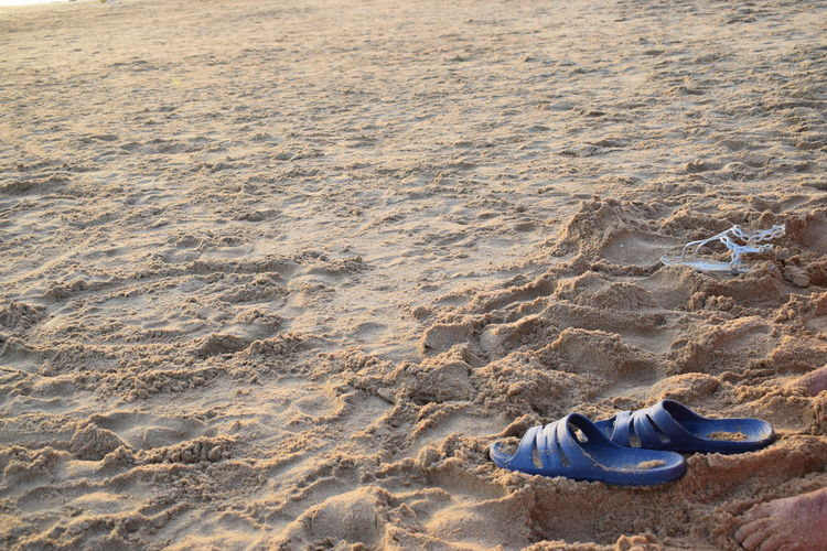 Flip flops on sand at beach