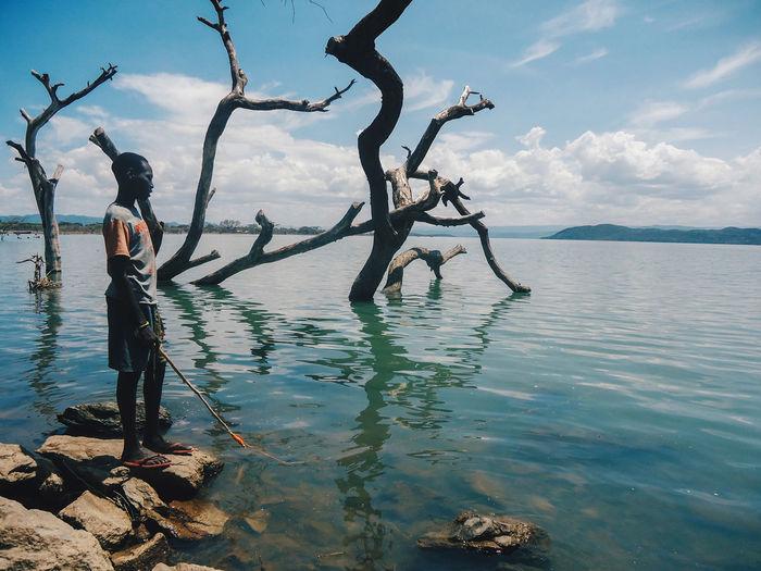 Lake Bogoria, Rift Valley, Kenya Travel Destinations Travel Photography Travel Kenya Lake Bogoria Rift Valley Water Sea Tree Beach Standing Sky Landscape Cloud - Sky Fisherman Calm Fishing Horizon Over Water Shore