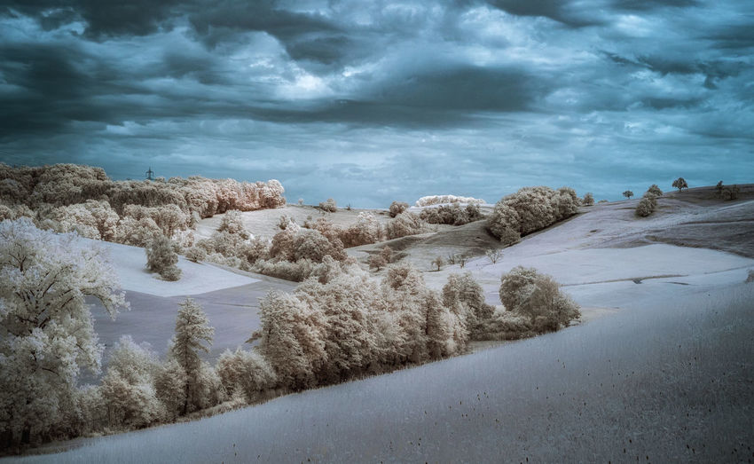 Scenic view of and against sky in infrared