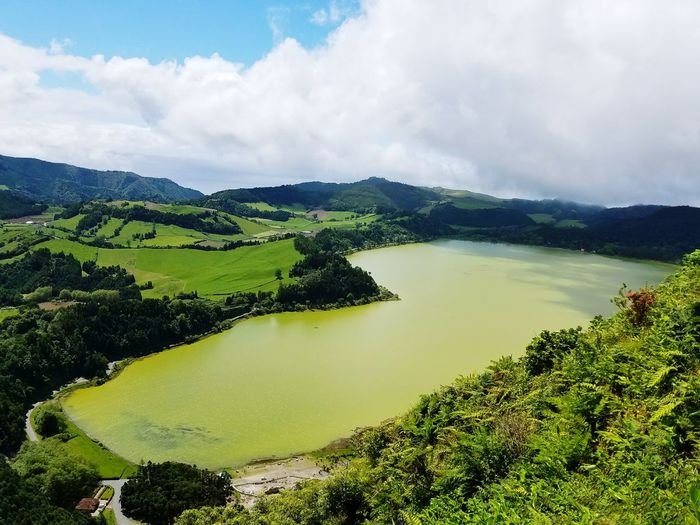 EyeEm Nature Lover EyeEm Best Shots Portugal Lake High Angle View Green Color Cloud - Sky Gorgeous Peaceful Photography Serenity Landscape Tree Water Mountain Lake Rural Scene Forest Sky Landscape Cloud - Sky Lush - Description Lush Foliage Calm Greenery