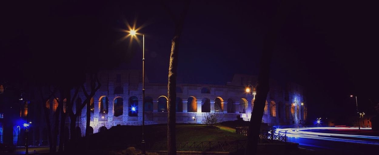 Colosseo Roma Architectural Column Architecture Building Exterior Built Structure City City Life Glowing Illuminated Light Light Trail Lighting Equipment Long Exposure Motion Night No People Road Sky Spraying Street Street Light Transportation Travel Travel Destinations