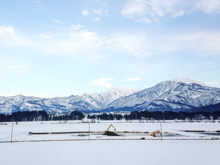 View of snow covered landscape with mountains in winter