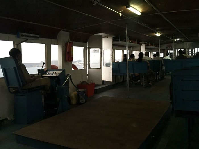 Indoors  Boat Passengers Boat Driver Perspective Benches Group Of People