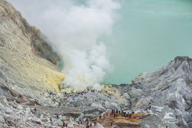 Aerial View Of People On Volcanic Landscape