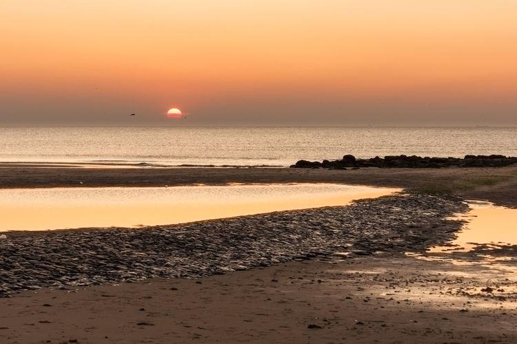 Sunset at Kijkduin, Den Haag EyeEm Market © Sky Water Sunset Sea Beach Tranquility Horizon Over Water Sony A700 Den Haag Kijkduin The Netherlands Horizon Tranquil Scene