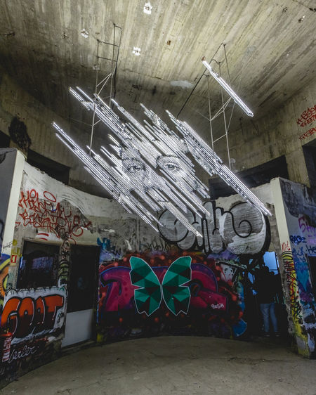 Graffiti on wall in abandoned building