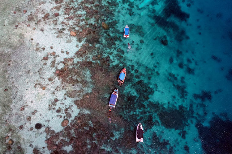 High angle view of boat on sea is taken by drone, indonesia